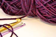 Stock Photo of crochet hooks and purple yarn