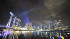 Time lapse of the Marina Bay Singapore skyline light show at night Stock Footage