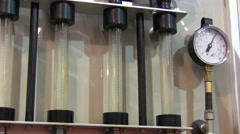 Industry details - glass tubes and pressure gauge - stock footage