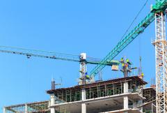Construction site with worker on blue sky Stock Photos