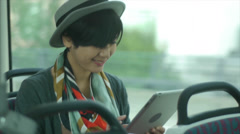 Pretty Young Asian Woman Using A Digital Tablet On A Train Stock Footage