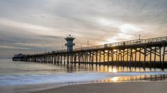 Dramatic sunset at seal beach pier in orange county california Stock Photos