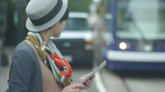 Young Asian Woman With A Digital Tablet Waiting For & Then Getting On A Train Stock Footage