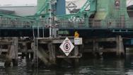 Stock Video Footage of limit 6 knots sign on bridge