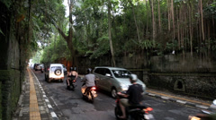Motor vehicle traffic on main road into Ubud, Bali - time lapse Stock Footage