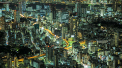 Time lapse of a Tokyo cityscape at night Stock Footage