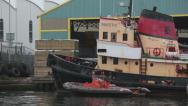Stock Video Footage of industrial tug boats and quay