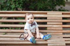 child on the bench - stock photo