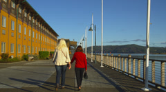 Two Women Walking Together in Coos Bay, Oregon - stock footage