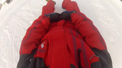 Happy person having fun joy sledging down the mountain ski slope winter snow Stock Footage