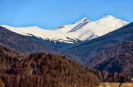Stock Photo of snow covered mountains and rocky peaks in the romanian carpatian