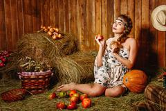 Girl in rustic barn Stock Photos