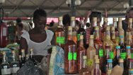 Stock Video Footage of Martinique local market homemade alcohol bottle HD 1436