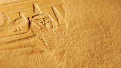 Sands blow away to reveal ancient Egyptian hieroglyphics Stock Footage