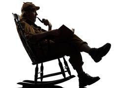 sherlock holmes reading silhouette - stock photo