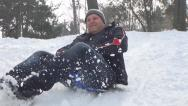 Stock Video Footage of Adult Man Sledding on Child, Kid Sledge, Sled in Park, Winter Games in Snow