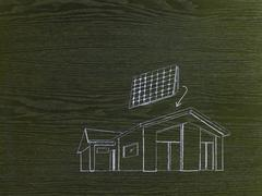 Stock Illustration of a line drawing image on grained wood. a green building project, a house with