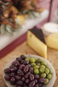 A buffet table laid out for a party. organic food. a cheese board selection, Stock Photos