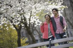 people outdoors in the city in spring time. new york city park. a man and wom - stock photo
