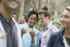 People outdoors in the city in spring time. new york city park. two women in  Stock Photos
