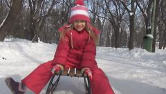 POV Man Sledging Child, Kid on a Sleigh in Park, Little Girl Sledding in Winter Stock Footage