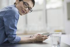 professionals in the office. a light and airy place of work. a mature woman i - stock photo