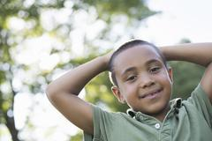 a young boy outdoors on a summer day. - stock photo