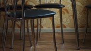 Stock Video Footage of chairs put under the table