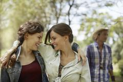 Two friends smiling at each other. Stock Photos