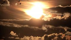 Sunrise Through Flowing Dark Clouds Stock Footage
