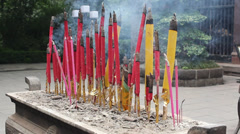 Joss sticks and candles - stock footage