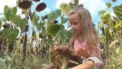 Child Eating Sunflower Seeds, Girl Playing in Countryside Field, Crop, Children - stock footage