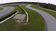 Red Ferrari on race track, aerial view Stock Footage