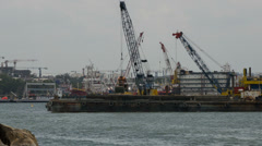 Singapore Port with Moving Cranes Doing Maintenance Work with Clouds Time Lapse Stock Footage