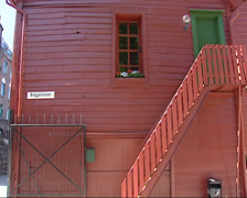 Pan + tilt Old-style wooden house in Bryggen, the old wharf of Bergen Stock Footage