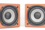 Stock Photo of wooden sound speakers isolated on white background