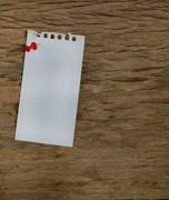 Stock Photo of blank notepad on a wooden surface