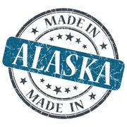 made in alaska blue round grunge isolated stamp - stock illustration