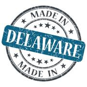 made in delaware blue round grunge isolated stamp - stock illustration