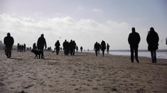 People walking on the beach Stock Footage