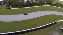 Ferrari 458 on race track, aerial view from above Stock Footage