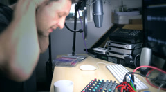Radio presenter spills coffee over himself Stock Footage