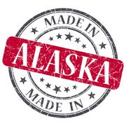 Made in alaska red round grunge isolated stamp Stock Illustration
