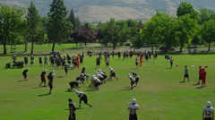 High School Football Practice on Green Field Stock Footage