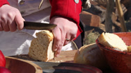 Stock Video Footage of Continental Soldier slicing bread (Revolutionary War)