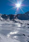 frozen river in mountain high, freezing solar day - stock photo