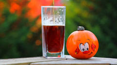 Beer Next to Fall Pumpkin Stock Footage