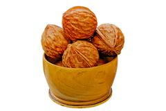 Walnuts from juniper wood in a vase Stock Photos