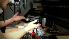 Radio presenter between songs - stock footage