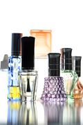 Many bottle with perfume different color isolated. Stock Photos